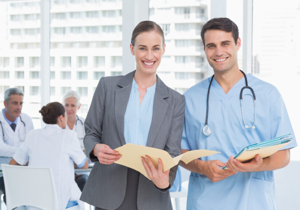 Male and female doctors with reports in the hospitals